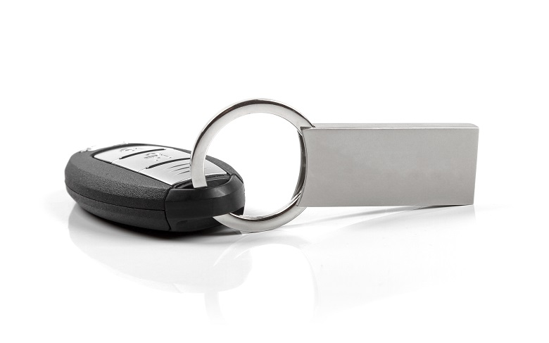 car key with blank keyring isolated on white